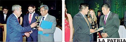 Pedro Adrián Calizaya, presidente de la Estación de Autobuses Oruro, y Eddy Carlos Plaza García, gerente propietario de Multicines Plaza, al momento de ser galardonados