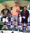 Luis Copa en el podio con la medalla de plata