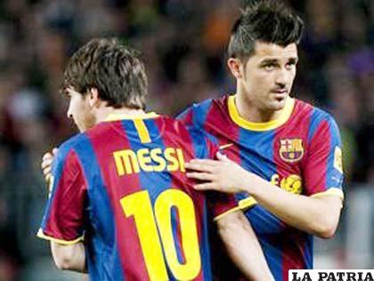 Lionel Messi y David Villa, jugadores del Barcelona