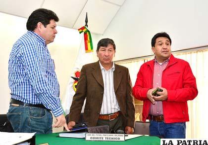 Roger Bello, Freddy Fernández y Jorge Decormis