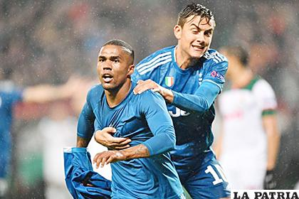Douglas Costa anotó el gol del triunfo de Juventus ante Lokomotiv Moscú /meridiano.com