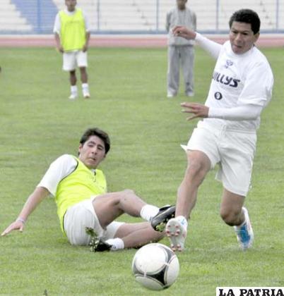 Ferrufino y Saucedo en el entrenamiento de ayer