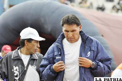 Marcos Ferrufino junto a su asistente Mario Parrado